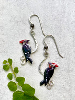 "Pileated woodpeckers are a favorite bird. It is always a thrill to experience the flash of black, white and red, with the soundtrack of their loud calls and hammering. These earrings pay tribute to this special bird. They are hand crafted out of jeweler's brass and Sterling silver, and carefully hand colored. They measure 1/2"" wide by 1"" tall without their Sterling earring wires. They are light and comfortable to wear and make the perfect gift!"