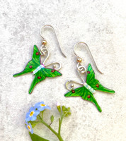 "Luna moths are one of the many wonders of nature. These luna moth earrings are a tribute to them. They are handpainted and sealed with a protective layer of resin. They measure 1"" tall by 3/4"" wide. They are light to wear and make a great gift for a friend or for you!"
