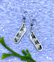 "The Twelve-spotted skimmer is a dragonfly that is found across North America. It is distinctive in that its wings have contrasting spots of black and white. These twelve-spotted skimmer wing earrings are a tribute to such a special creature. I fabricate them out of Sterling silver wire, and then use a technique that I developed to create translucency in jewelry. I add the spots, layer on protective resin, et voila, they are ready to fly. They measure 1 1/4"" long by 3/8"" wide, not including their Sterling earring wires. They are light as a dragonfly to wear and make the perfect gift!"