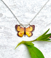 "Orange Sulphur Butterflies are found across North America. They are a lovely summer butterfly. This necklace is a tribute to them. It is hand crafted out of lacquered jeweler's brass and Sterling and carefully hand-colored. It measures almost 1"" wide by 3'4"" tall, and is strung on a 16"" Sterling chain. It would also work on an 18"" chain, and if you would prefer that, let me know in the notes.  It is the perfect gift for you or a friend!"
