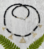 For those of us who can use some lovely levity these days, the Lighter Than Air Dancing Pyramid Necklace enters, stage right. It is comprised of five handmade Sterling spiraled pyramids of graduated sizes, strung with black and gold glass beads, and finished with a handmade clasp, featuring, what else....a little spiral. So why lighter than air? The spiral itself is a powerful image that suggests a connection to infinity, a potentially light concept. These spirals feature translucency....pretty airy....and are embellished with little golden dots, which suggest, what else(?)--light! And then there is the fact that the pyramid shape symbolizes rays from the sun. So all in all, the necklace is a beautiful way add a bit of bling and lighten the mood at the same time. It measures an ample 21 inches.
