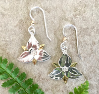 """When Roethke wrote, """"Deep in their root, all flowers keep the light"""", he could have been referring to the winsome trillium. These earrings are in honor of the flower and the light that it brings to the forest floor. They are handcrafted out of Sterling silver and jeweler's brass, and have a protective finish applied to prevent tarnish. They measure 3/4"""" x 3/4"""" not counting the length of the Sterling earring wires. They are light and comfortable to wear, and would be the perfect gift for yourself or a friend."""