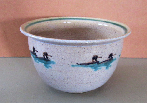 """Created here in the Adirondacks, this piece is hand thrown and hand painted with a pair of loons on still water.  Approx. 4"""" tall x 8"""" diameter. Oven and dishwasher safe. Matching mugs, pitchers and pie plates also available."""