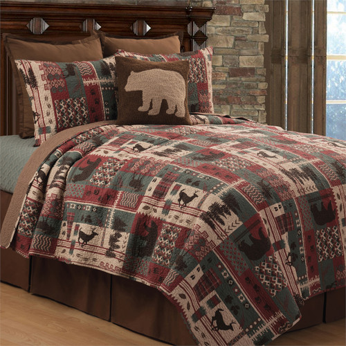 The North Ridge Quilt set has images of bear, deer, moose and trees in a patchwork style.