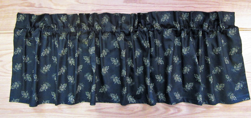 "Waverly Pinecone valance measures 53"" x 14"". Pinecone design in beige on black."