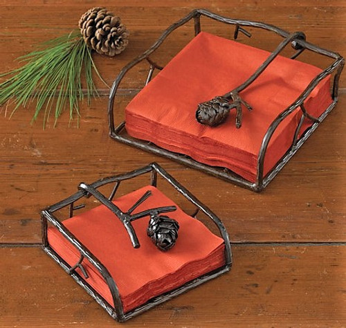 """This iron napkin holder is crafted to resemble pine branches with a pine cone. Comes in 2 sizes; 5.5"""" square and 7.5"""" square."""