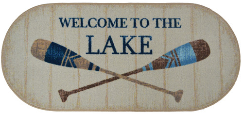 """This 20"""" x 44"""" oval rug with durable serged edges, non-slip rubber backing, is machine washable. Tan with browns and blues, features crossed oars and the words 'Welcome To The Lake'."""