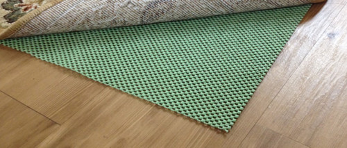 This rug pad holds your rug safely in place, protects your floors, is 100% quality rubber and is easily cut with scissors