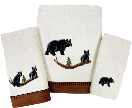 Black Bear Towel Collection features embroidered black bears, moms and cubs with faux suede coordinating trim on the bath and hand sizes on a 100% cotton ivory towel.