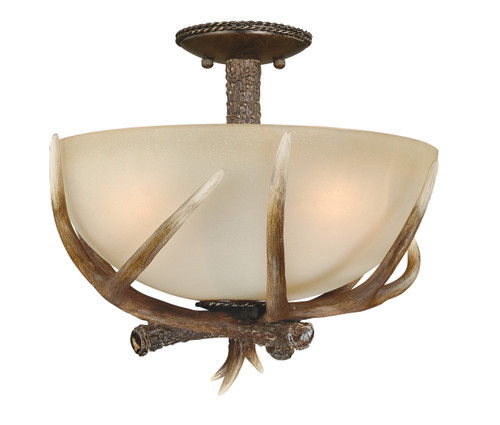 """Black Walnut Finish and Creme Cognac Glass beautify this 17"""" semi-flush ceiling light. Faux antlers accentuate the rustic look, perfect addition to the cabin. Measures 13"""" long and 17"""" in diameter."""