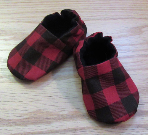 These cute Buffalo Check boys booties have elastic at the back and are lined with soft black fabric.