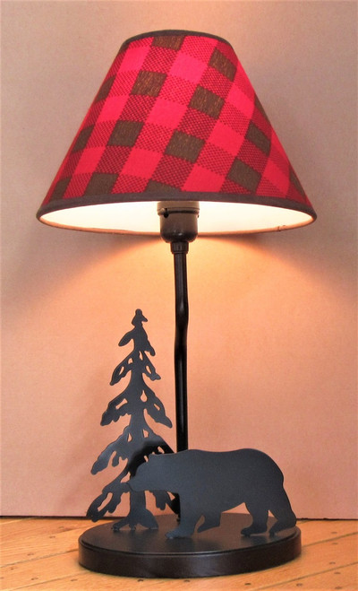 "Black metal lamp features a bear and a pine tree silhouette. Base is 8"" across, lamp is 18"" high. Buffalo Check shade is 11"" diameter at bottom."