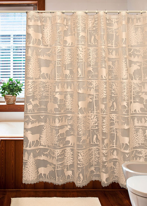 """The Lodge Hollow Shower Curtain features a variety of interesting silhouettes from majestic pines to wildlife, perfect for your rustic retreat. Natural color. Measures 72"""" x 72""""."""