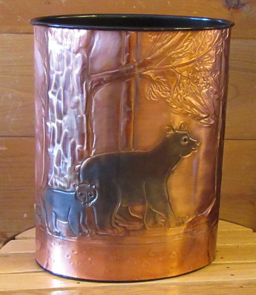 "Beautifully embossed copper on this wastebasket shows a mother bear with her cub walking in the woods. Hand made in the Adirondacks. Measures 13"" x 10""."