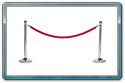 Chrome ball top stanchions with red velour ropes.