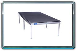 Quik Stage 4 x 8 Weather Resistant Desk With Non-Skid Poly Surface on Top, Polyvinyl on the Bottom Side, Sealed Edges, and an Aluminum Frame.