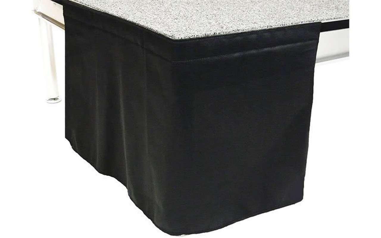 32 Inch High Flat No Pleat Black Polyester Top Rated Stage Skirting with Velcro. FR Rated. - Close up of Flat, no pleat, skirting on stage.