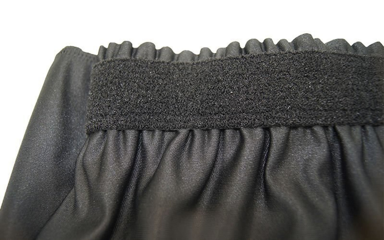 """Top rated 16"""" High Black Shirred Pleat Wyndham Flame Retardant Polyester Stage Skirting with the Loop Side Fastener.  - Closeup view of Loop side Velcro sewn on the back side."""