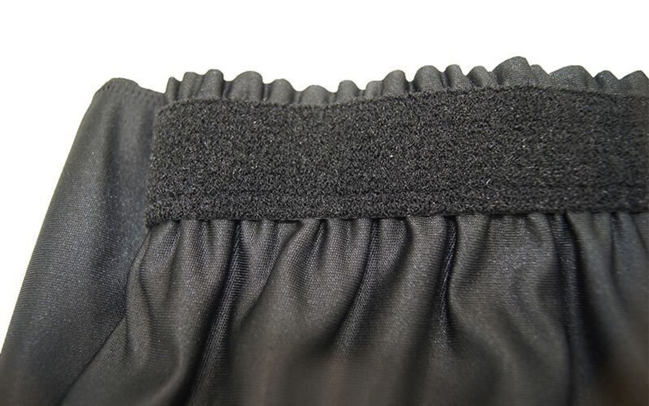 "Top rated 8"" High Black Shirred Pleat Wyndham Flame Retardant Polyester Stage Skirting with the Loop Side Fastener  - Closeup view of Loop side Velcro sewn on the back side."