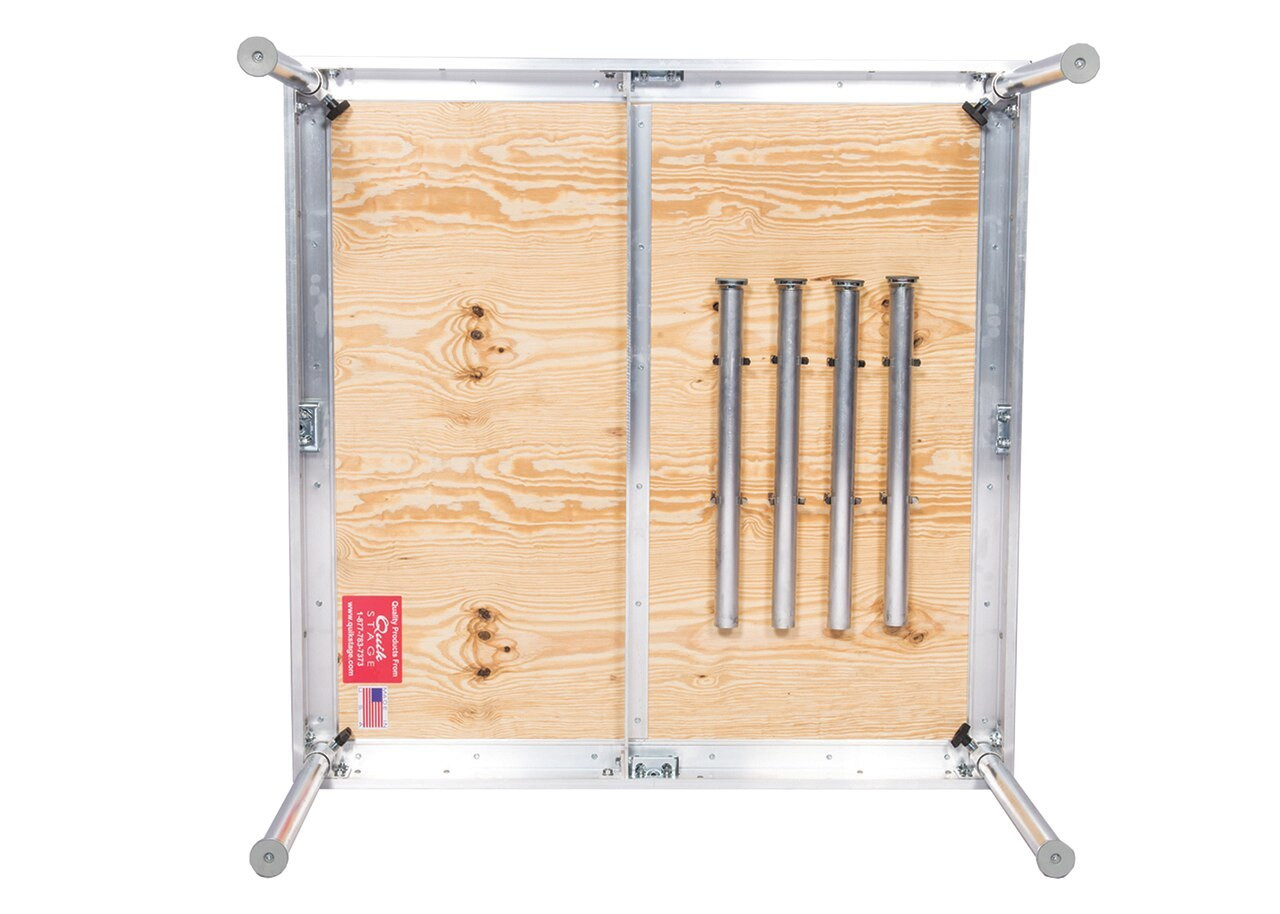 Quik Stage 8' x 8' High Portable Stage Package with Black Polyvinyl Non-Skid Surface. Additional Heights and Surfaces Available. - Stage legs shown in leg storage clips.