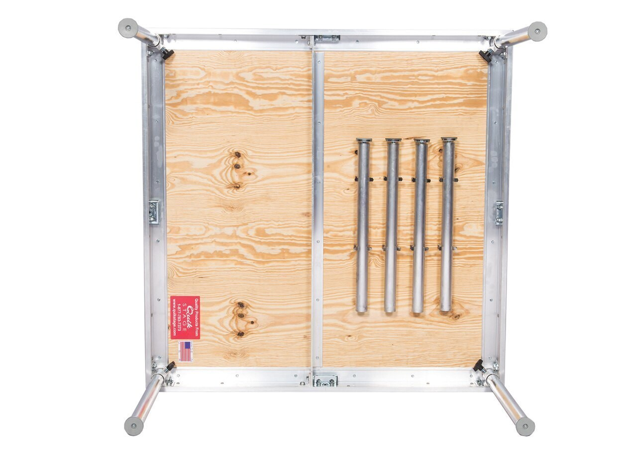 Quik Stage 8' x 12' High Portable Stage Package with Black Polyvinyl Non-Skid Surface. Additional Heights and Surfaces Available - Stage legs shown in leg storage clips