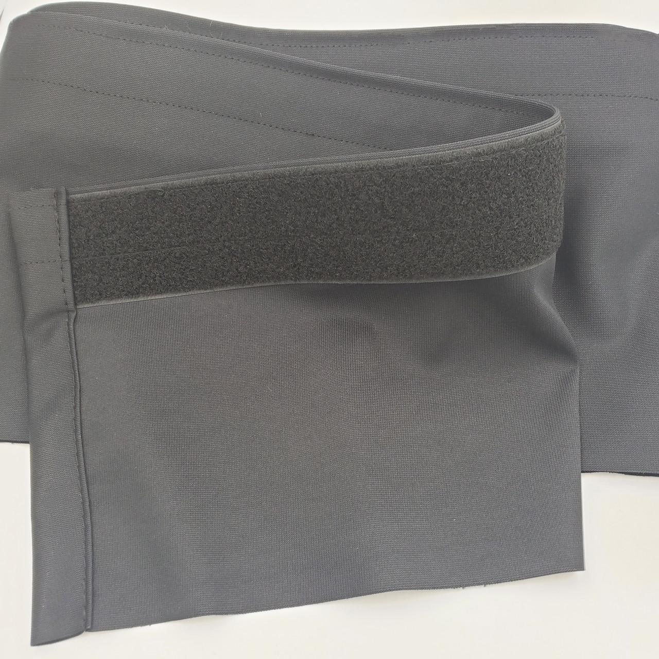 "Top rated Closeout!  8"" High x 12' Long Black Flat (No Pleat) Poly Premier Stage Skirting with Loop Velcro sewn on the back - Back Side"