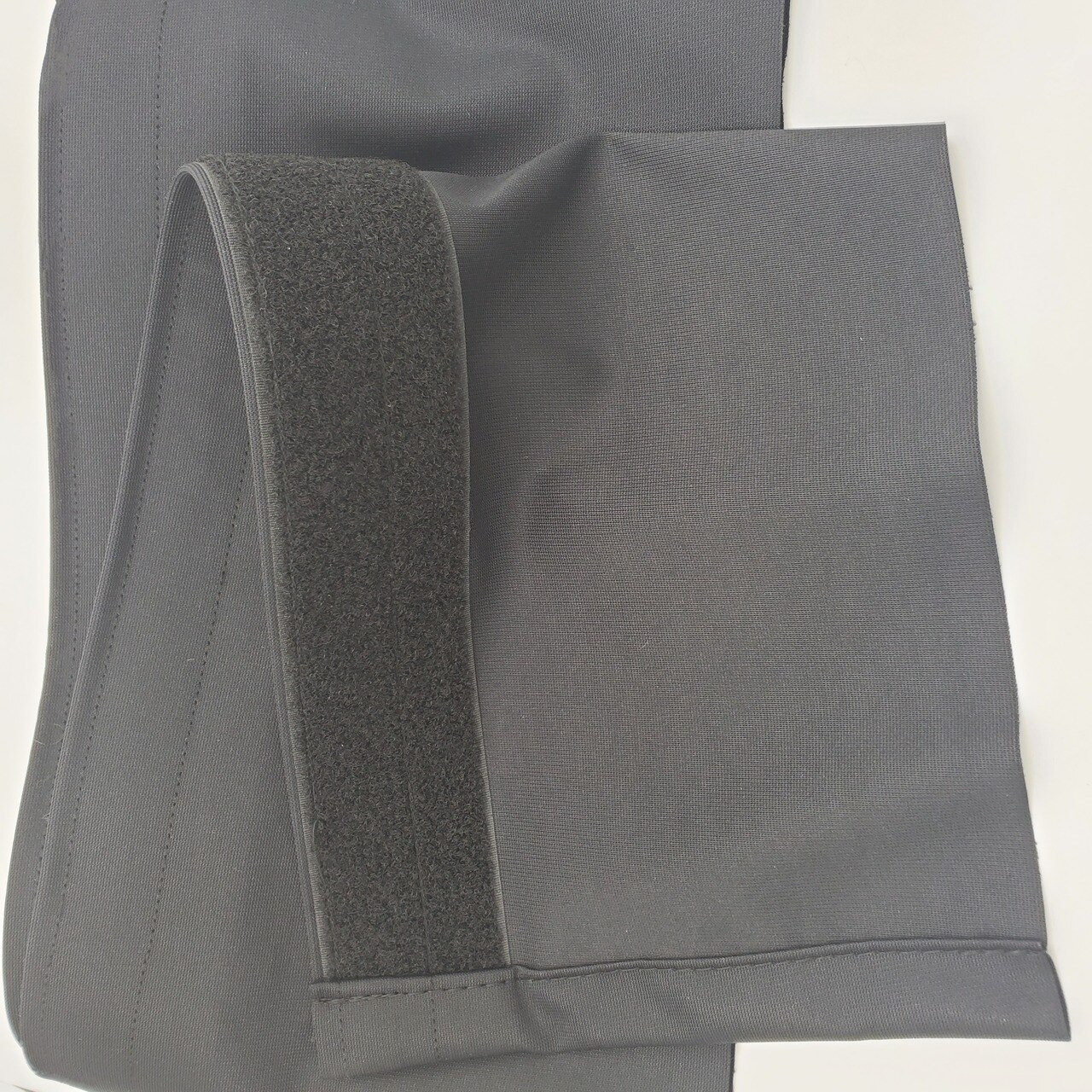 """Top rated Closeout!  8"""" High x 24' Long Black Flat (No Pleat) Poly Premier Stage Skirting with Loop Velcro sewn on the back - Back Side"""