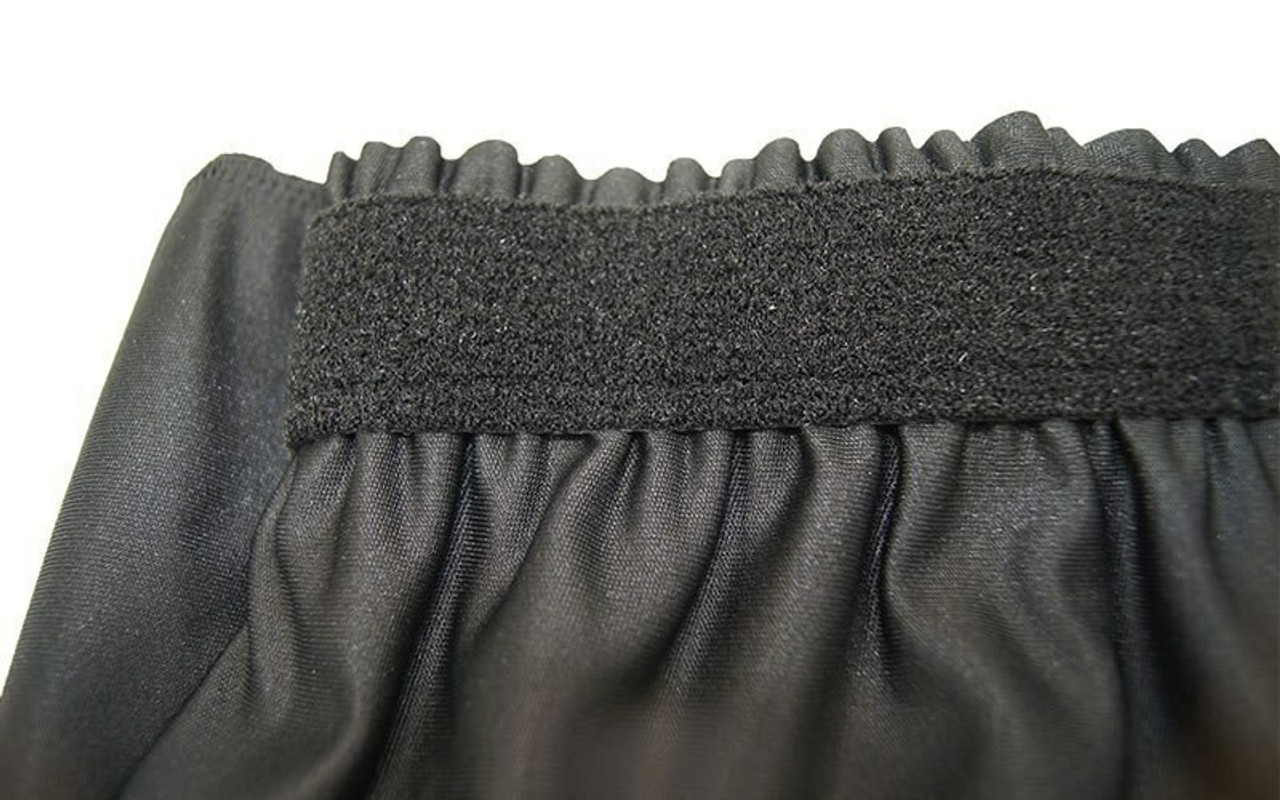 """Top rated 16"""" High Black Expo Pleat Poly Premier Flame Retardant Polyester Stage Skirting with the Loop Side Fastener.  - Closeup view of Loop side Velcro sewn on the back side."""