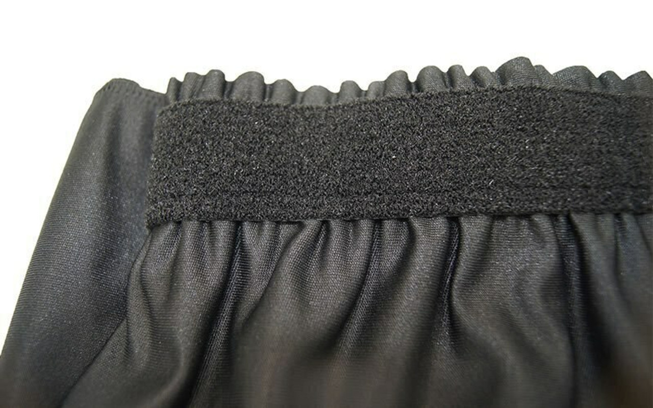 """Top rated 32"""" High Black Expo Pleat Poly Premier Flame Retardant Polyester Stage Skirting with the Loop Side Fastener.  - Closeup view of Loop side Velcro sewn on the back side."""