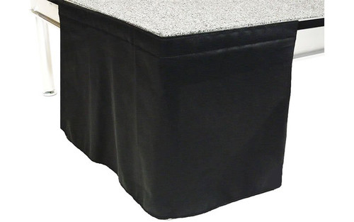 12 Inches High Flat No Pleat Black Polyester Stage Skirting with Velcro. FR Rated. - Close up of Flat, no pleat, skirting on stage.