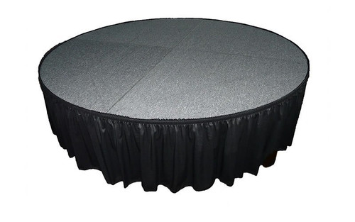 "Top rated 16"" High Black Shirred Pleat Wyndham Flame Retardant Polyester Stage Skirting with the Loop Side Fastener.  - Attached to a round stage."
