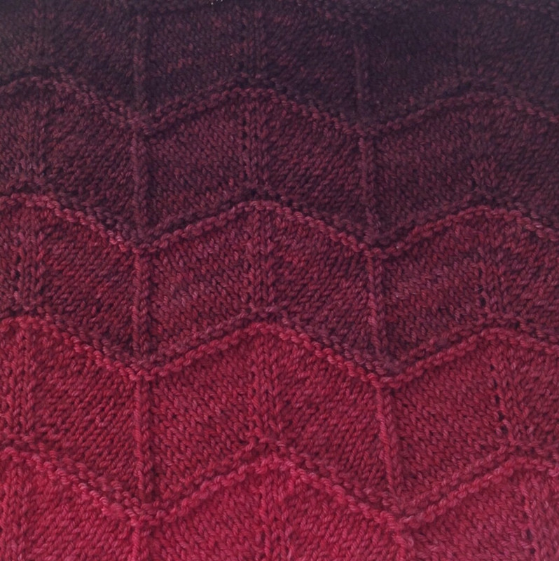 Red Shift shown knitted up in Fiar cowl, pattern by Three Irish Girls.