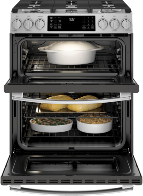 Two door oven with both doors open showing each oven filled with cooking dishes and food.