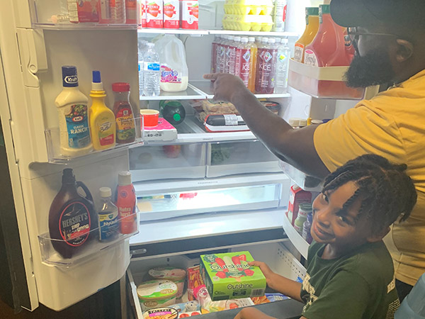 Allyson Silas's family takes a look inside their new refrigerator.