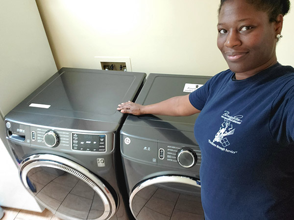 EMT Shunta Barbour snaps a selfie with her new washer and dryer pair.