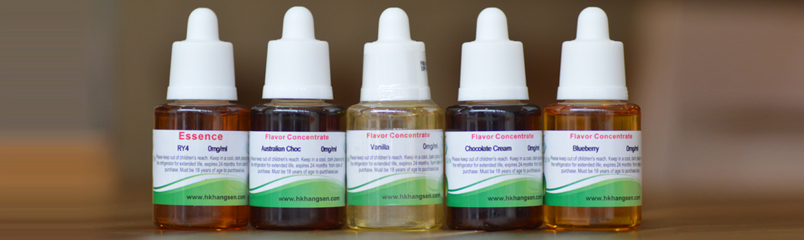 Five bottles of Hangsen concentrate on a wooden table