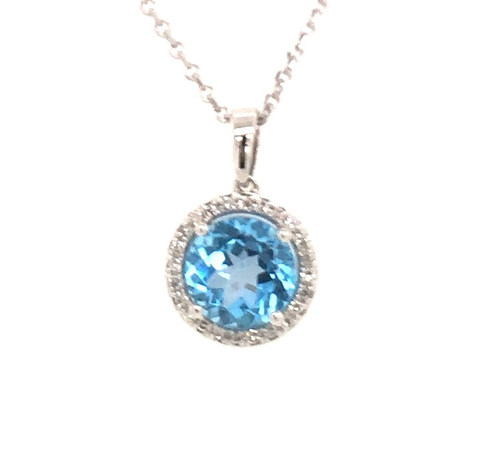 14 karat white gold blue topaz and diamond pendant.