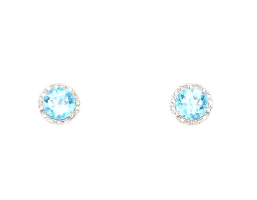 14 karat white gold blue topaz and diamond earrings.