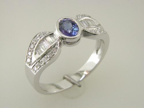 Custom design bezel set oval sapphire baguette and round diamond ring