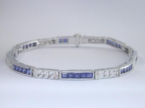 Custom design channel set princess cut sapphire/diamond bracelet
