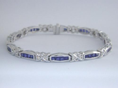 Custom design X's&O's channel set princess cut sapphire/diamond bracelet