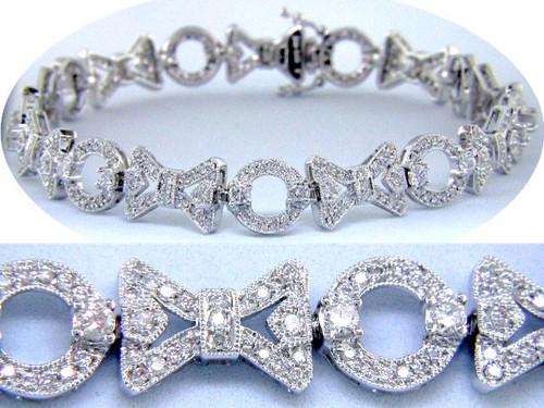 Custom design bow and circle pave' set diamond link bracelet