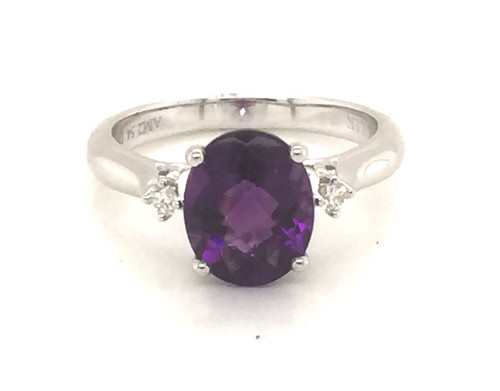 Oval amethyst and diamond ring.