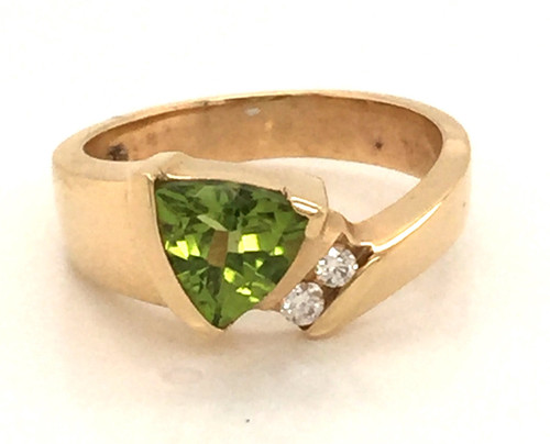 Triangular cut peridot and round diamond ring.