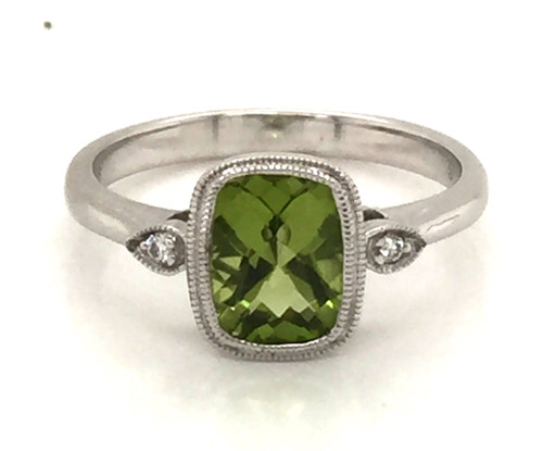 Cushion cut peridot and round diamond ring