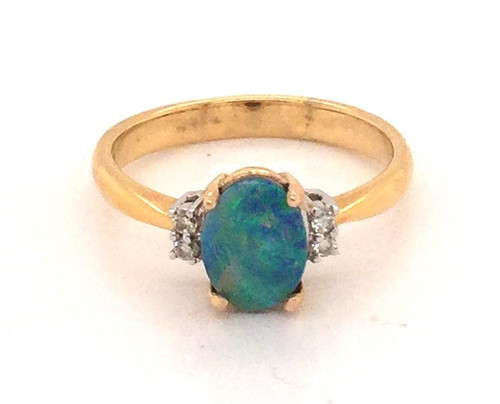 14 karat black opal triplet ring