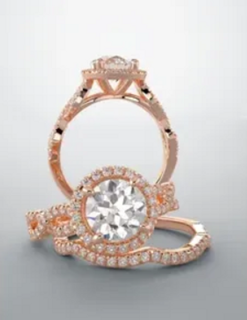 Halo center stone with crossover style ring shank. The ring is available for different shape and size center stones.