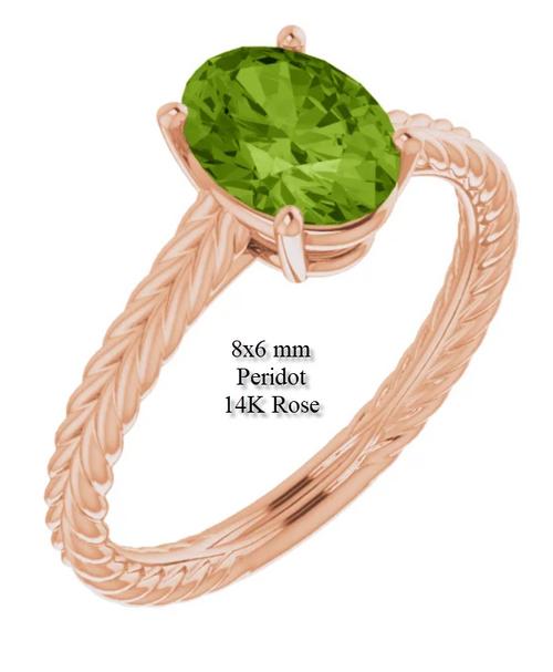 Peridot ring with a fancy weave shank.