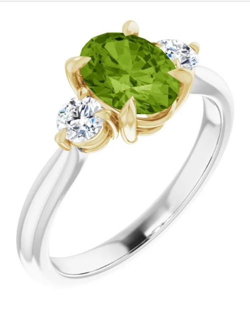Two tone oval peridot and diamond three stone ring.