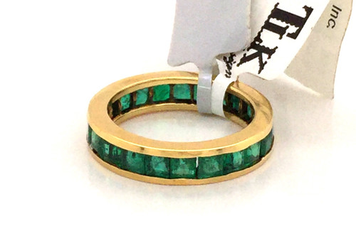 18kyg channel set Princess cut emeralds eternity band